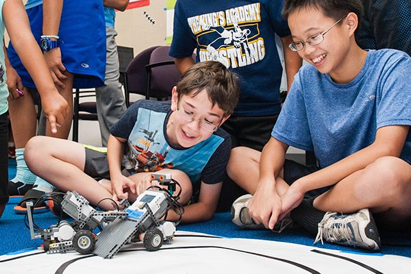 Tech campers play with arduino bot